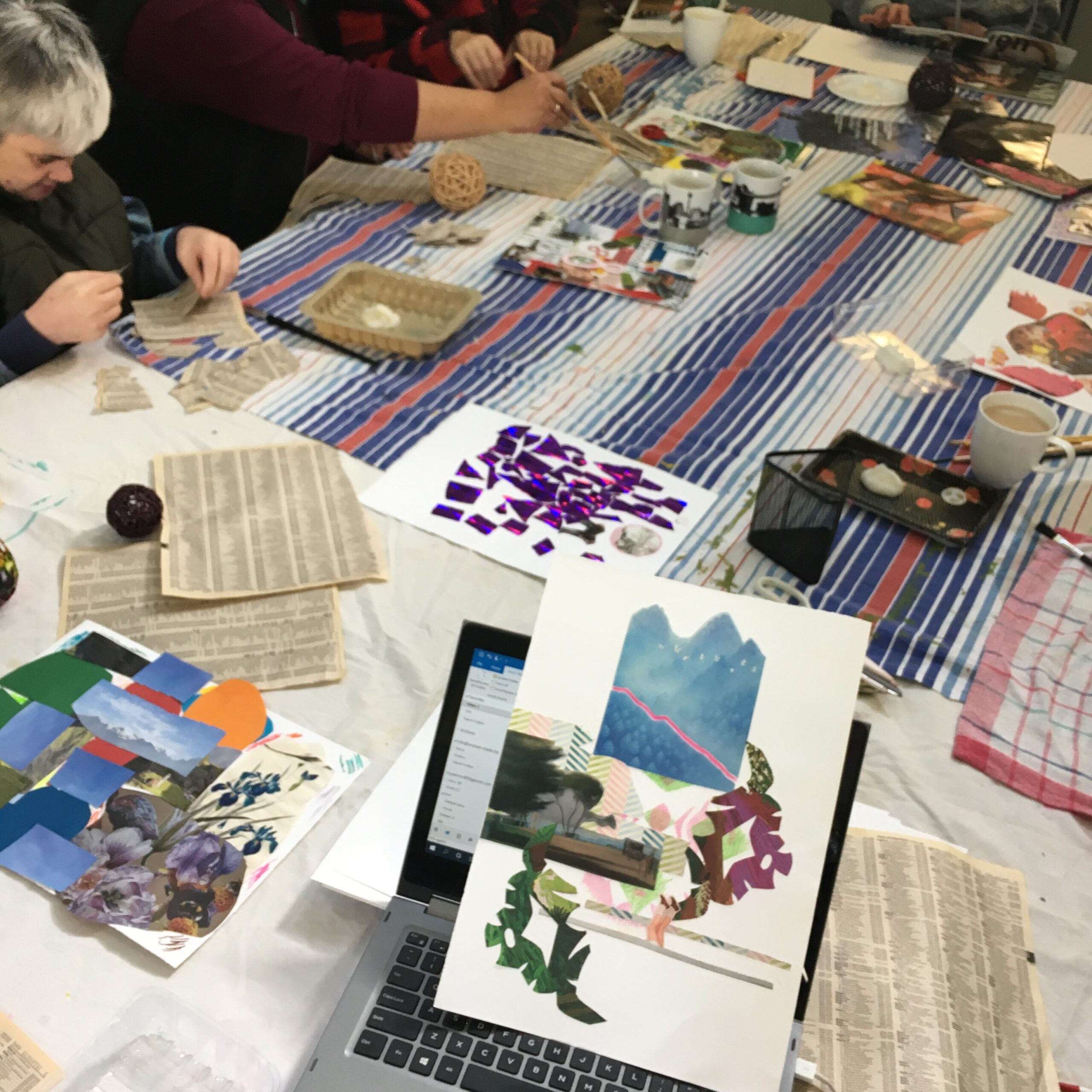 people making collages at a large table
