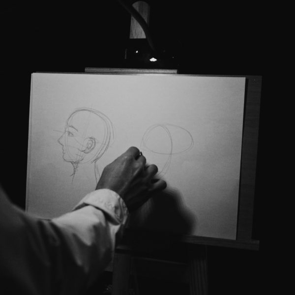 Person drawing a face