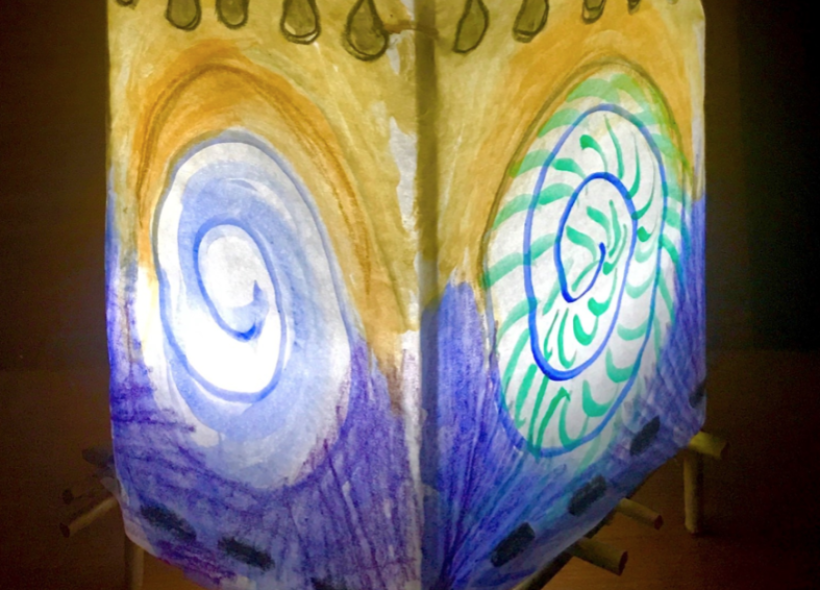 Painted lantern with light inside