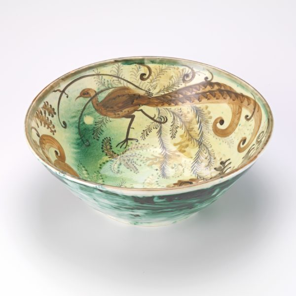 Bowl with lyre bird painted on it.