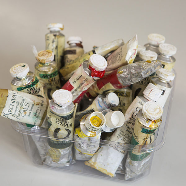 artists' paint tubes in a clear container