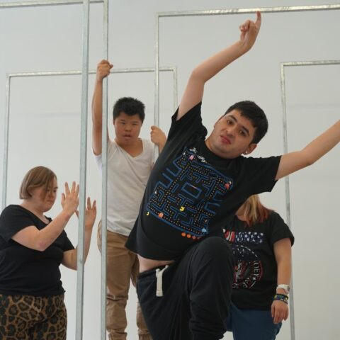 Group of dancers responding to objects and space.