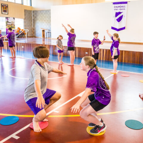 The photo is school aged children participating in a Limitless Leaps class.