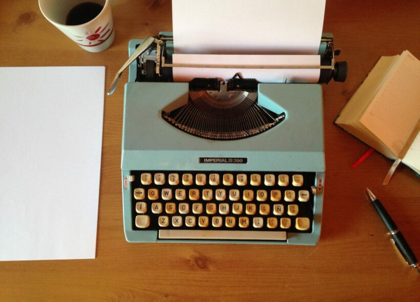 old typewritter and cup of coffee