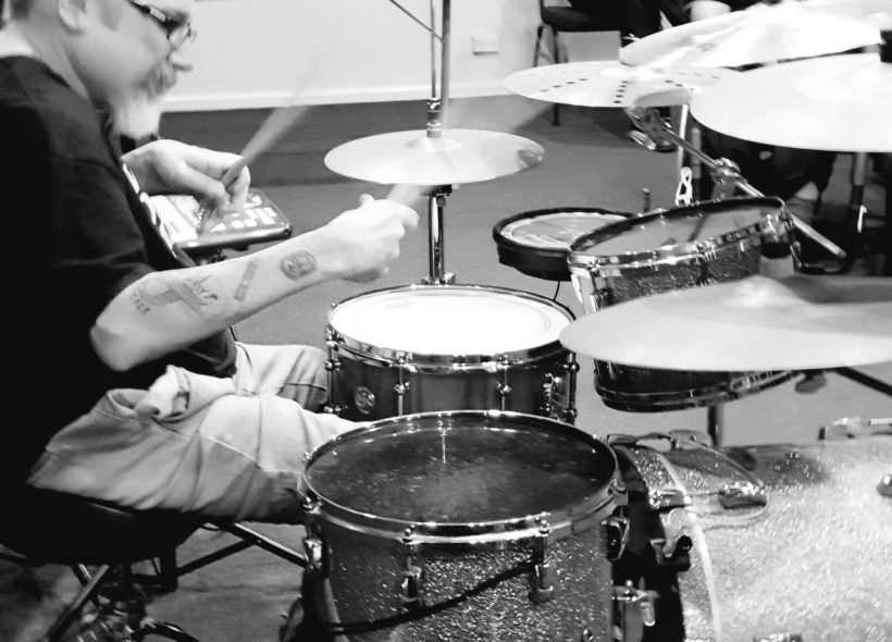 Andrew Hewitt wheelchair drummer performing behind a drum kit