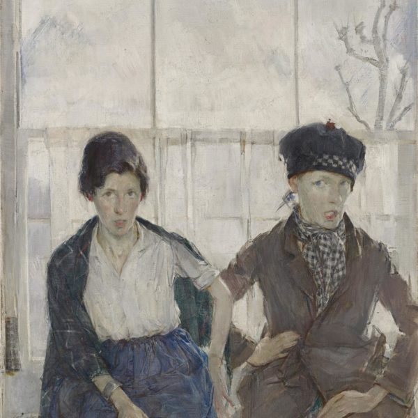 Two women sit in front of a large window