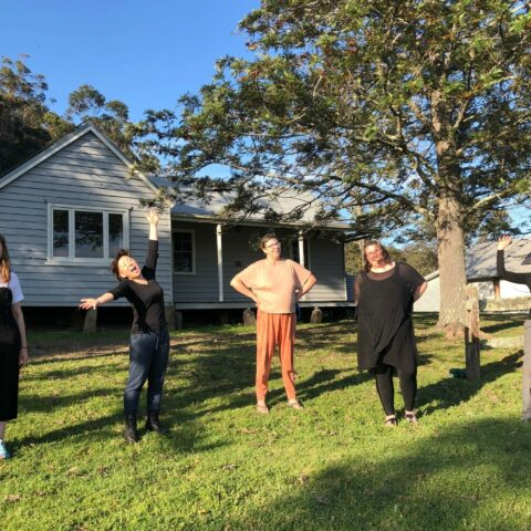 2020 Bundanon Residency Program participants. Five women of various ages and cultural backgrounds standing in front of a cabin in the bush.