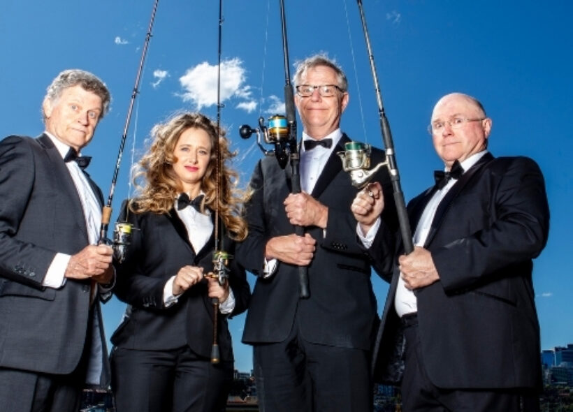 The cast of the Wharf Revue (L-R: Drew Forsythe, Mandy Bishop, Jonathan Biggins and Phil Scott) wear black tuxedo jackets and stand against a blue sky holding fishing rods.